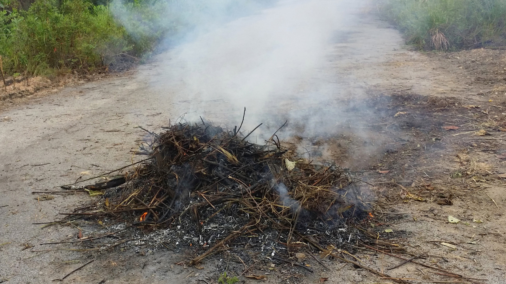 Outdoor burning taking place in a rural area