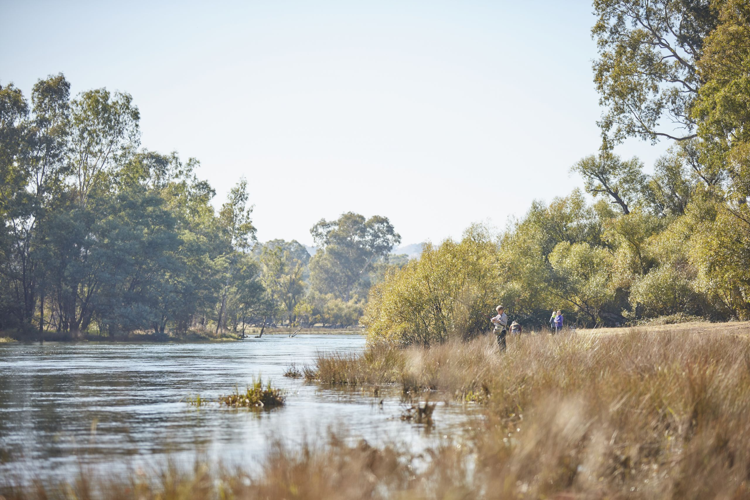 Rural scene of Goulburn river with people fishing