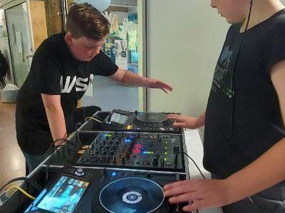two people dj-ing