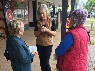 Councillor Karine Haslam talks with community member