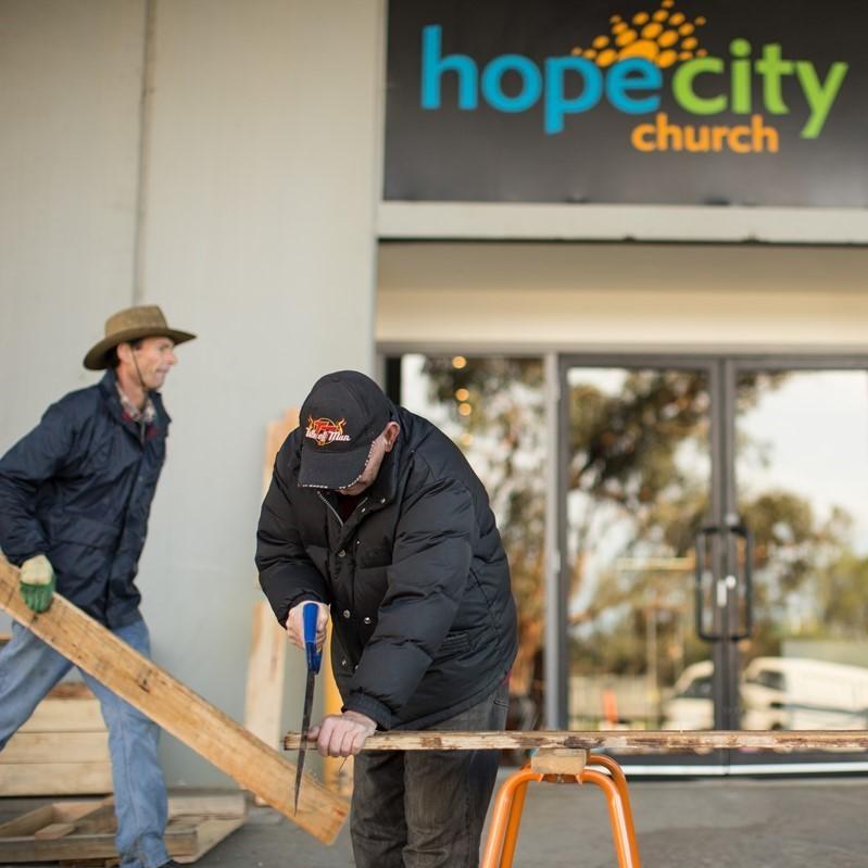 Volunteers building planter boxes