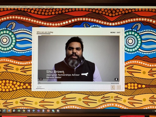 Computer screen showing a website with a picture of a person talking at camera.