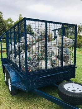 Picture of trailer filled with bags of collected rubbish