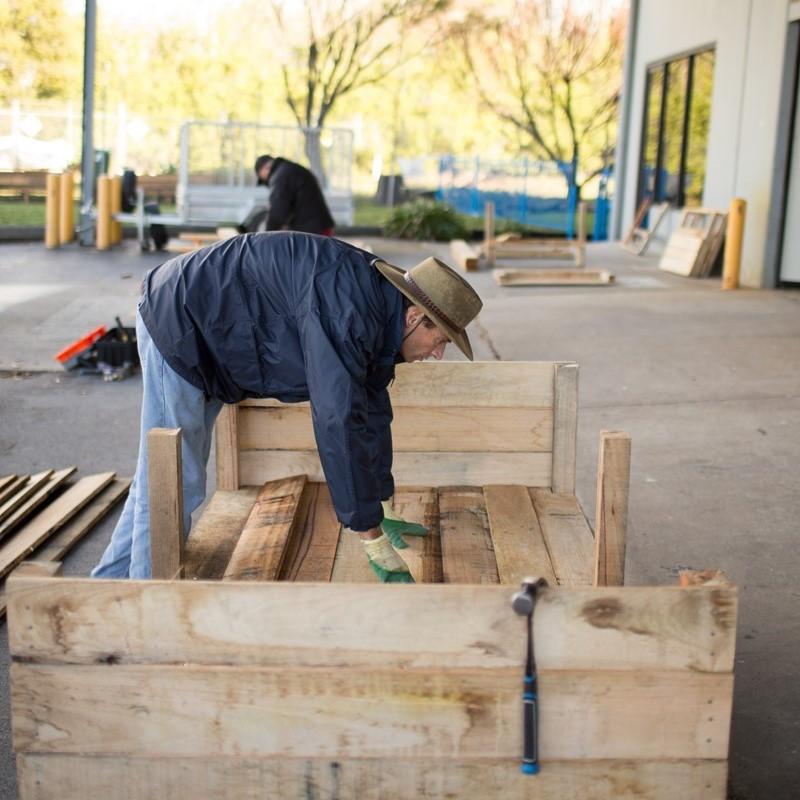 Volunteer building a planter box