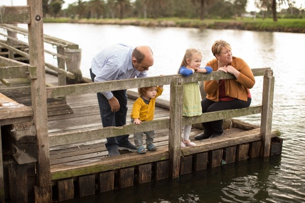 Image of family looking over water