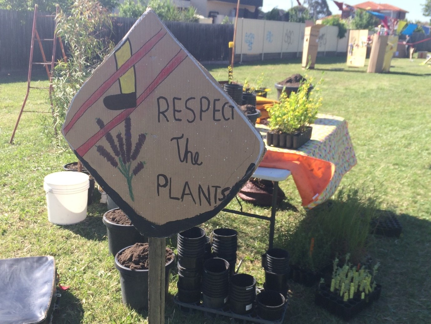 Plants and sign that reads