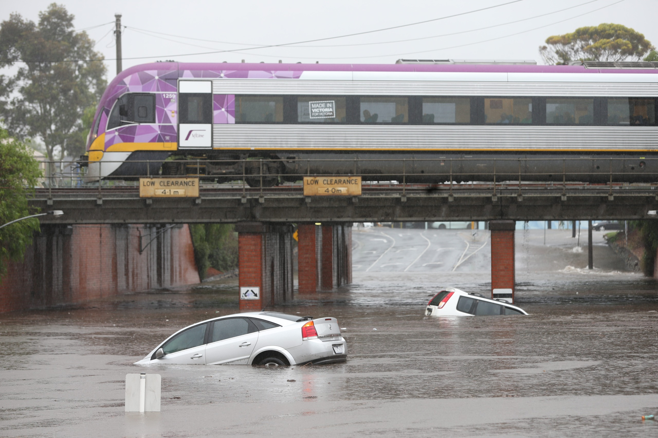 Photo of cars floating in flood waters