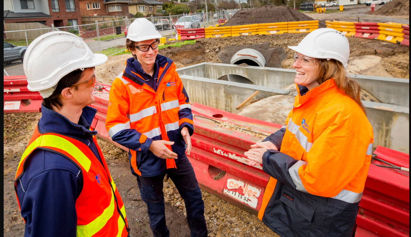 Melbourne Water team members building large flood pipes