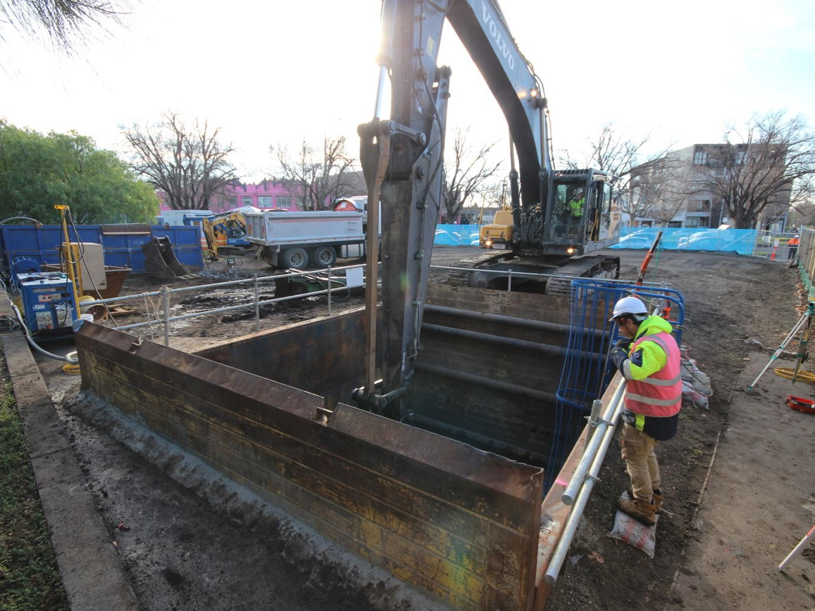 Photo of an excavator digging our tunnel launch shaft.