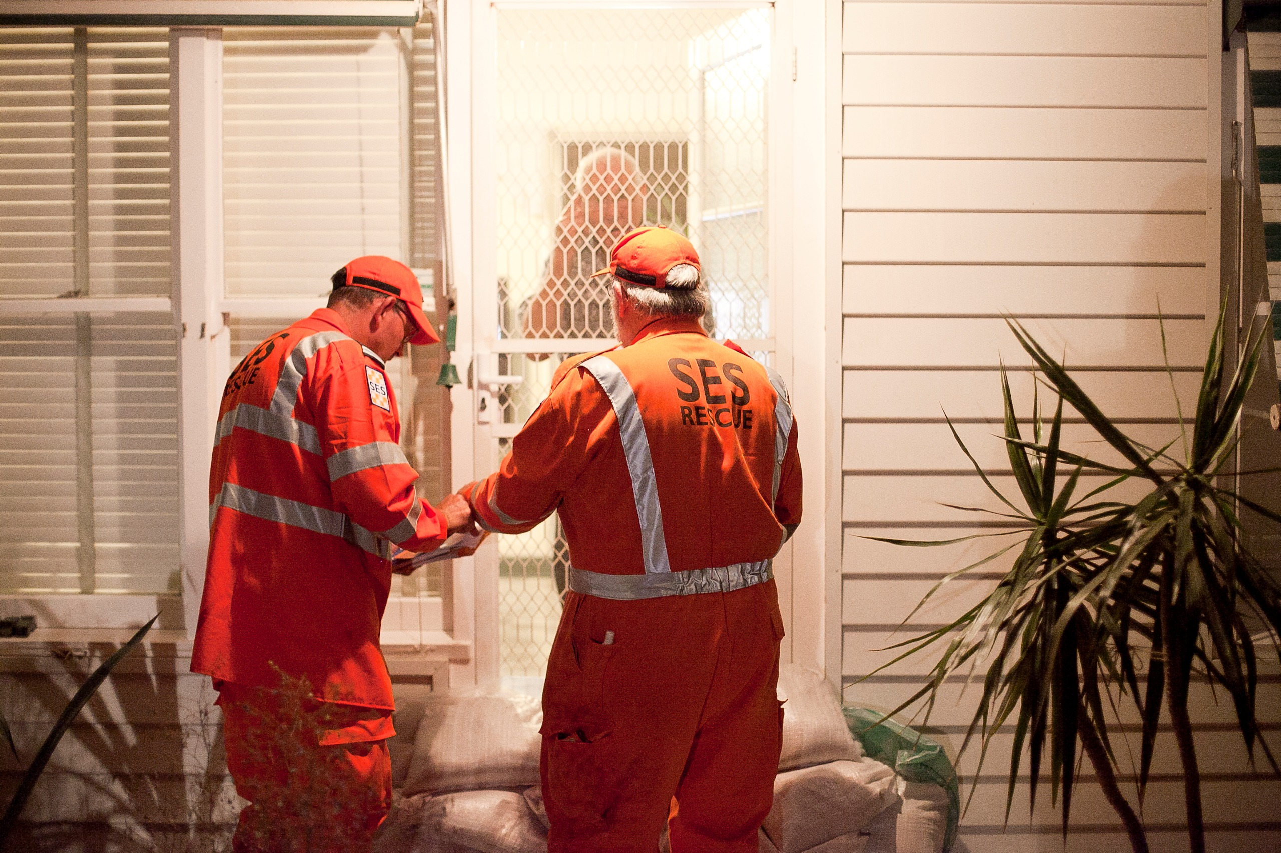 Victorian State Emergency Services team members door knocking