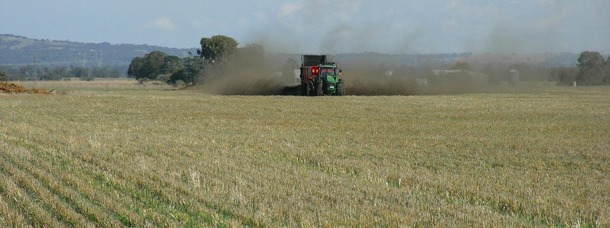 Machinery spreading biosolids on agricultural land