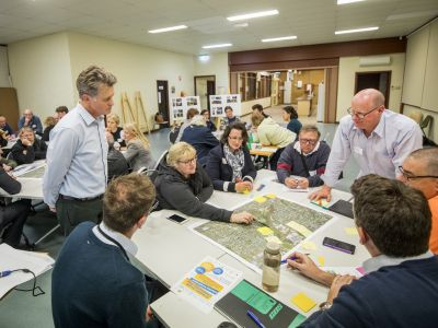 Tarralla Creek Community Advisory Group meeting with people sitting at tables