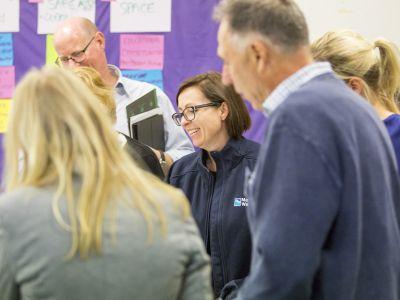 Tarralla Creek Community Advisory Group standing at tables with maps