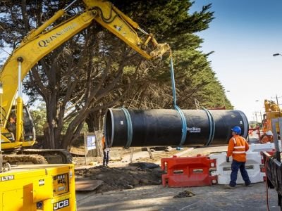 Image of the pipes being installed across High St in Reservoir