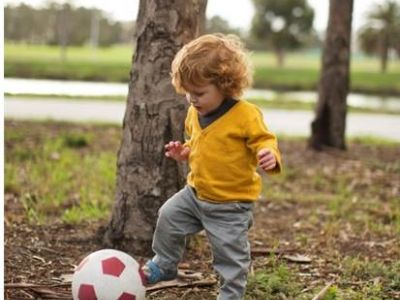 little boy kicking the ball