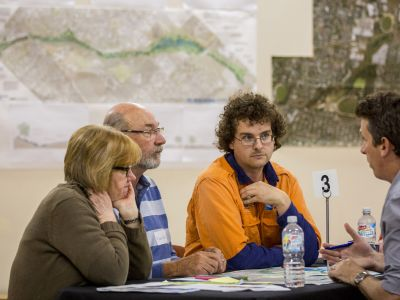 Community Advisory Group members sitting at table and discussing concept design