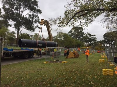 Image of pipes being unloaded