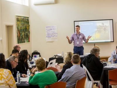 Man summarising concept design to Community Advisory Group members