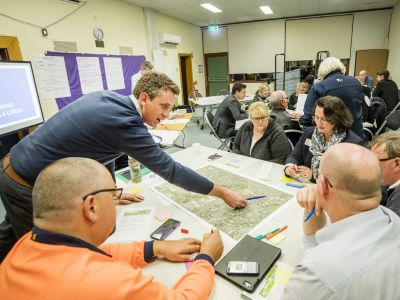 Tarralla Creek Community Advisory Group sitting at tables with maps