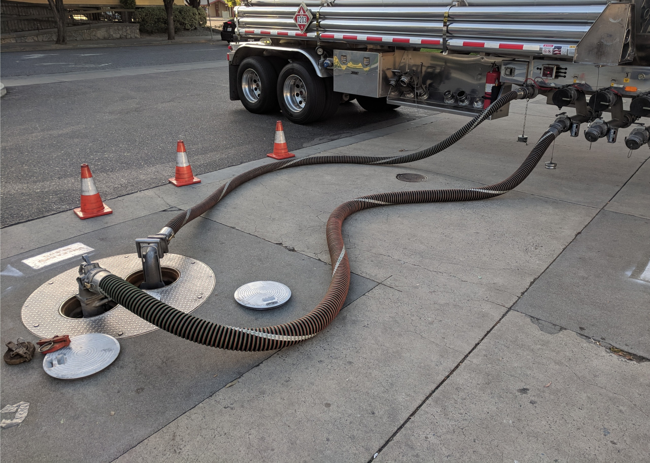 Underground petrol tank filling from truck