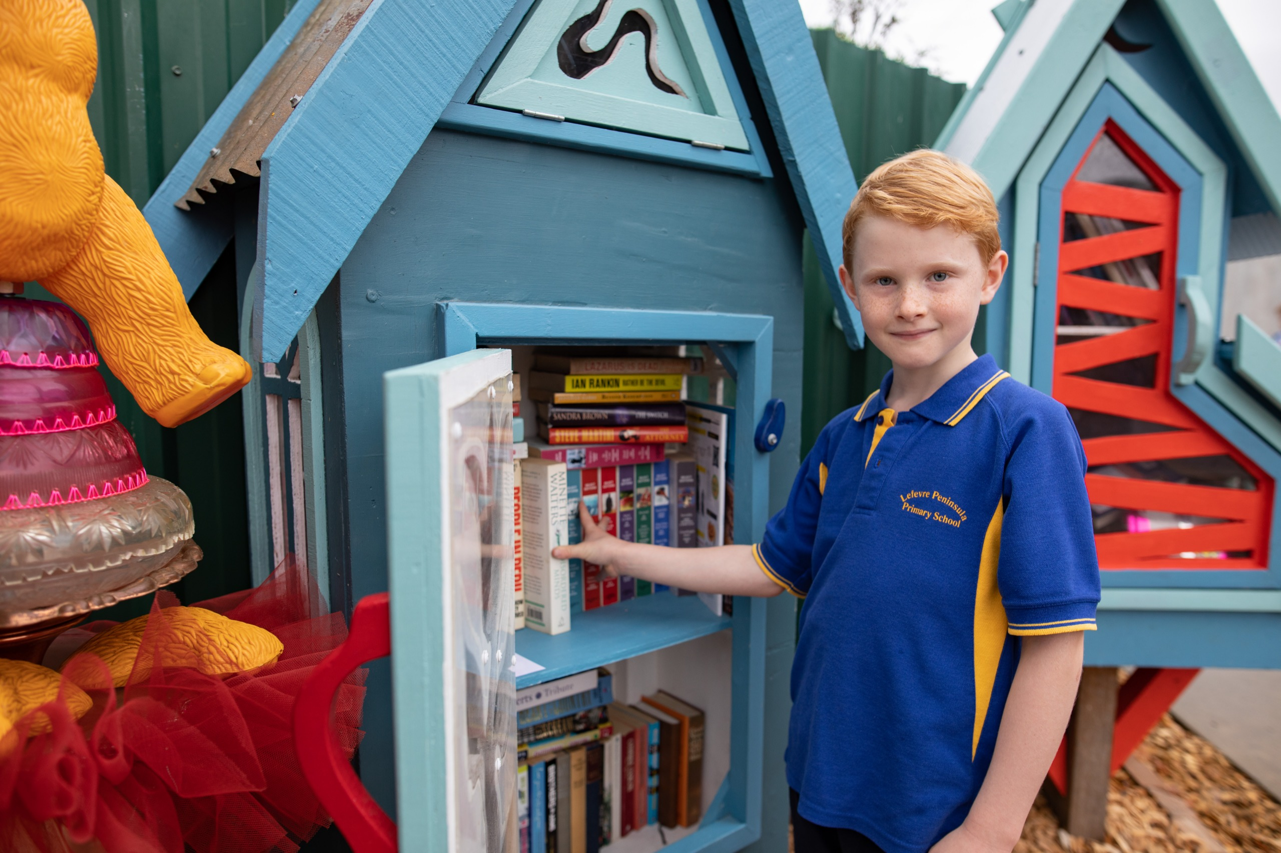 Image of little library - books in a small cupboard on the street.