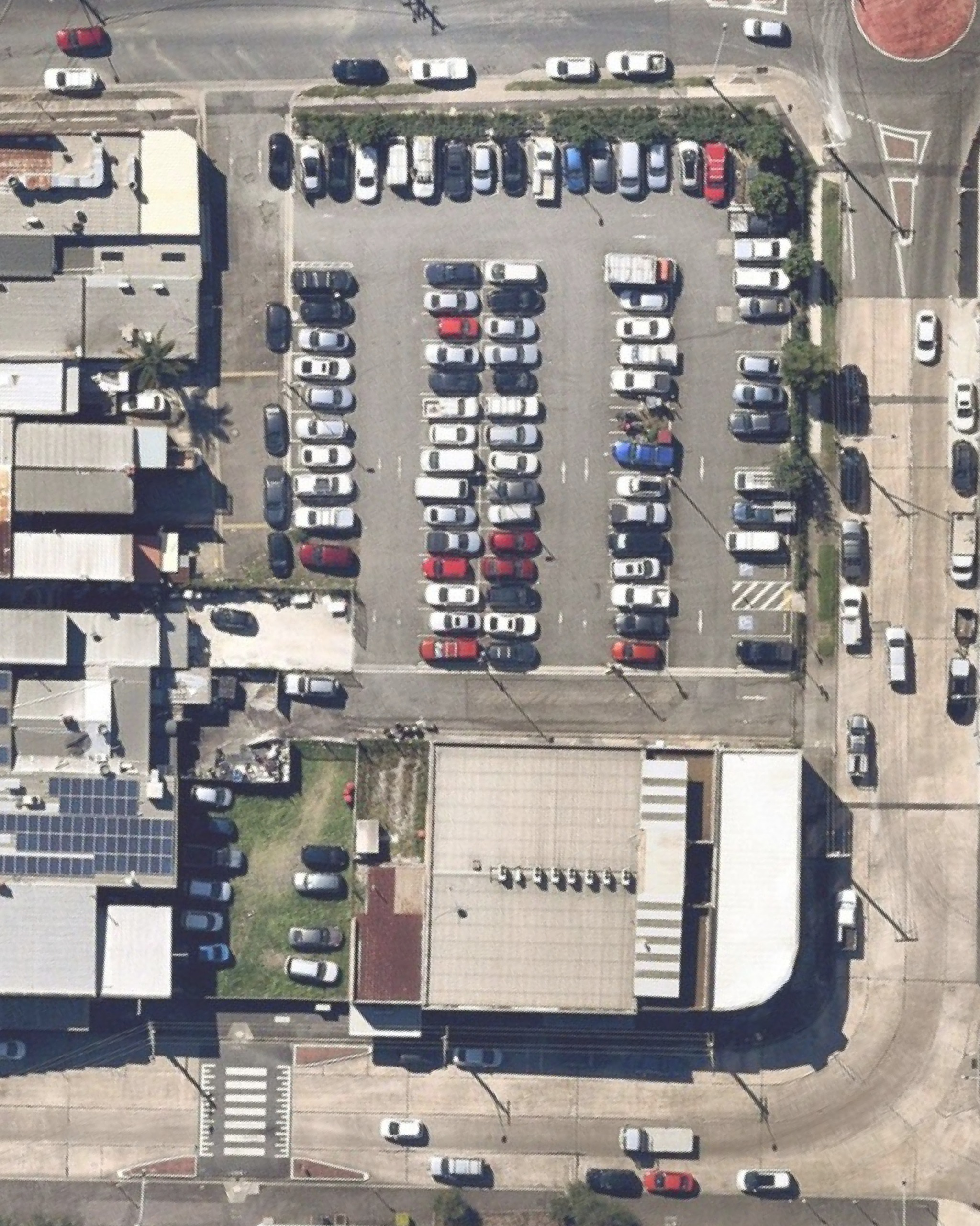Before: Image of current site which shows a birds eye view of the commuter car park next to Granville station on the northern side.