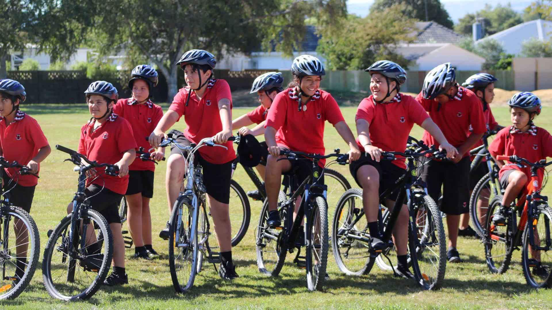 Photo shows kids from Takaro School riding Council-funded bikes.