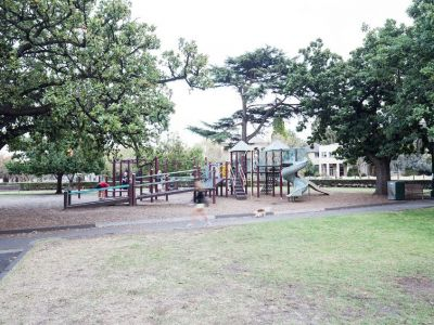 St Vincent Gardens playground for middle aged children, including a curvy slide, bridge and tanbark base.