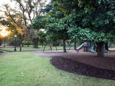 St Vincent Garden with grass, tanbark, playground and trees