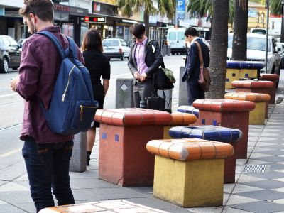 Tiled seating areas on Acland Street