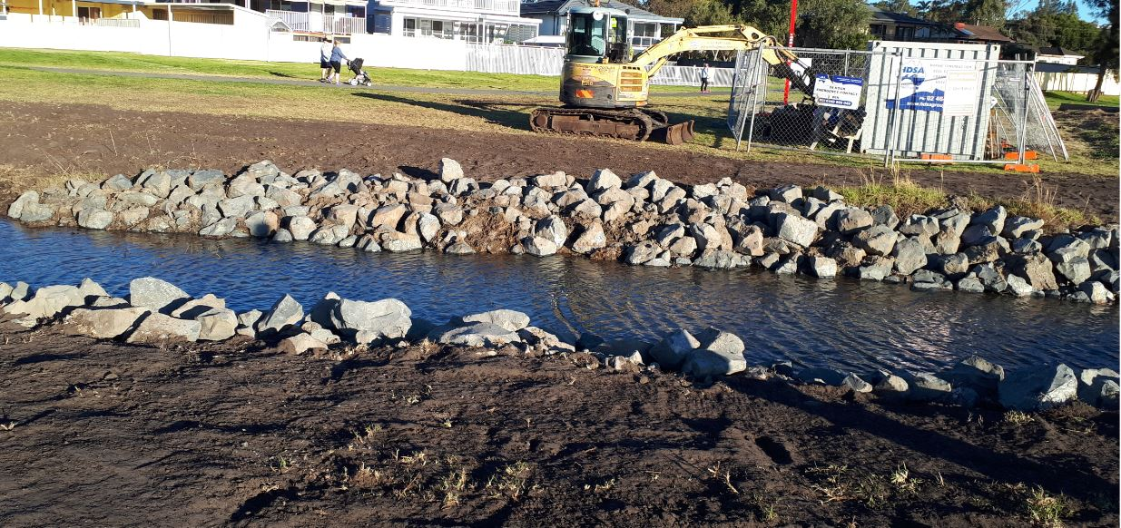 Rock armour foreshore protection to storm water channel.