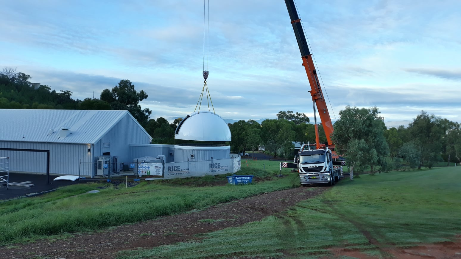 Custom built planetarium dome gets lifted onto the centre.