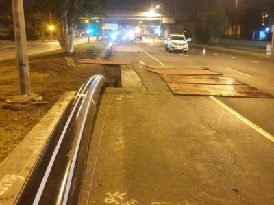 HDPE pipe lying on road at night as it is being feed through old water main as part of relining project