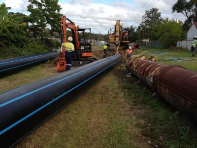 HDPE pipe being feed into old metal water main during relining project