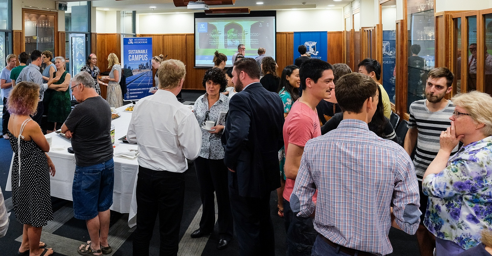 Staff, students and members of the Sustainability Executive mingle at the morning tea.