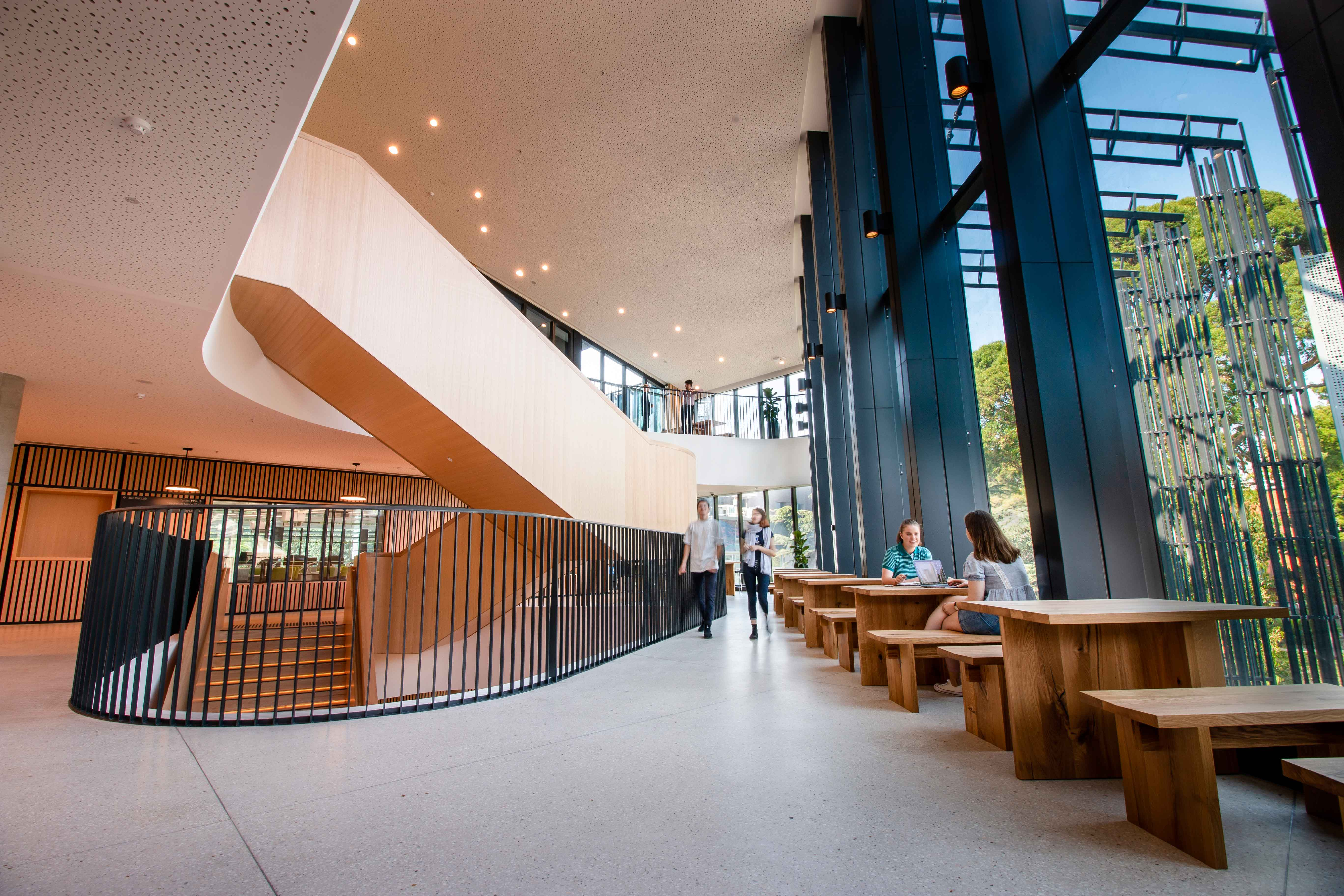 Ground level displaying a grand and modern space for students to meet.