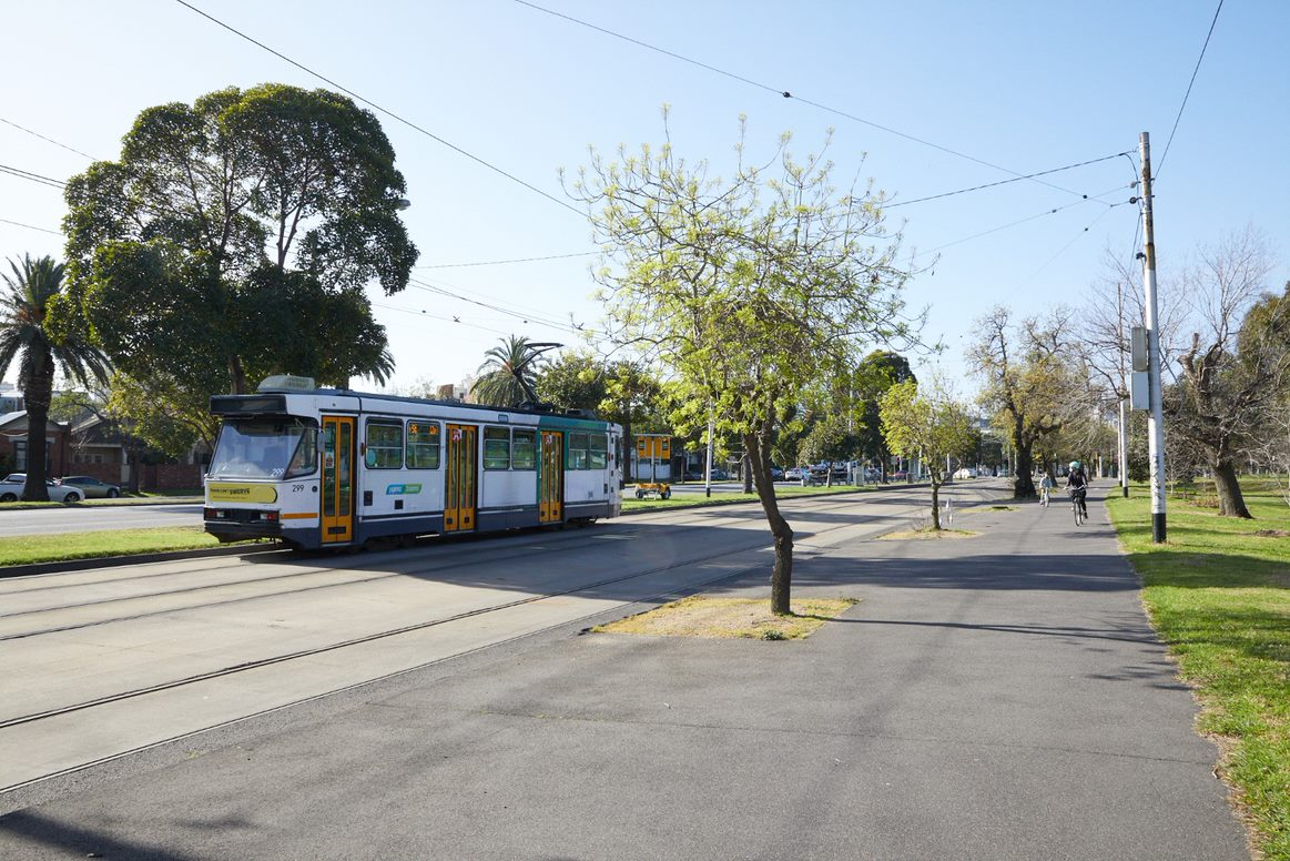 View of number 12 tram and pedestrian path on Albert Road