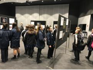 Students looking at the art exhibition