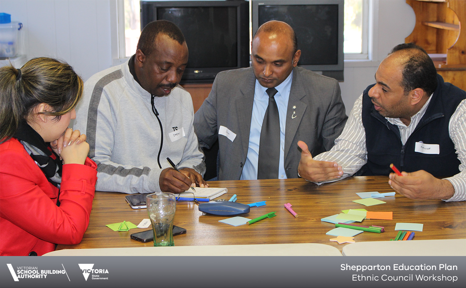 4 people working at a table for Ethnic Council workshop