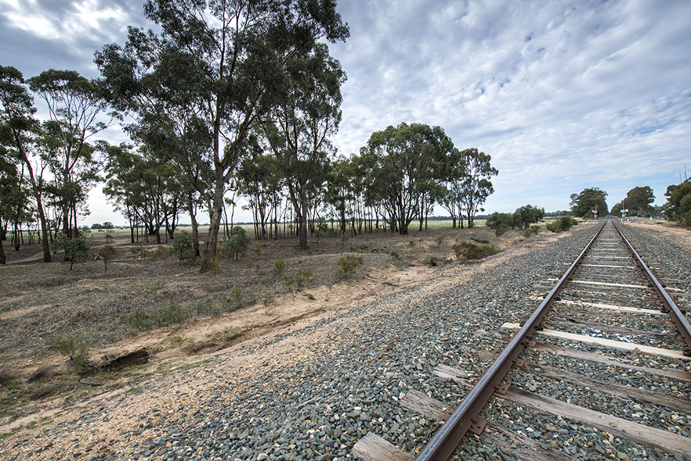 Photo of Huntly Station's possible location with train track and level crossing in background.