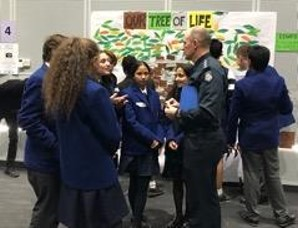 Police officer talks with students