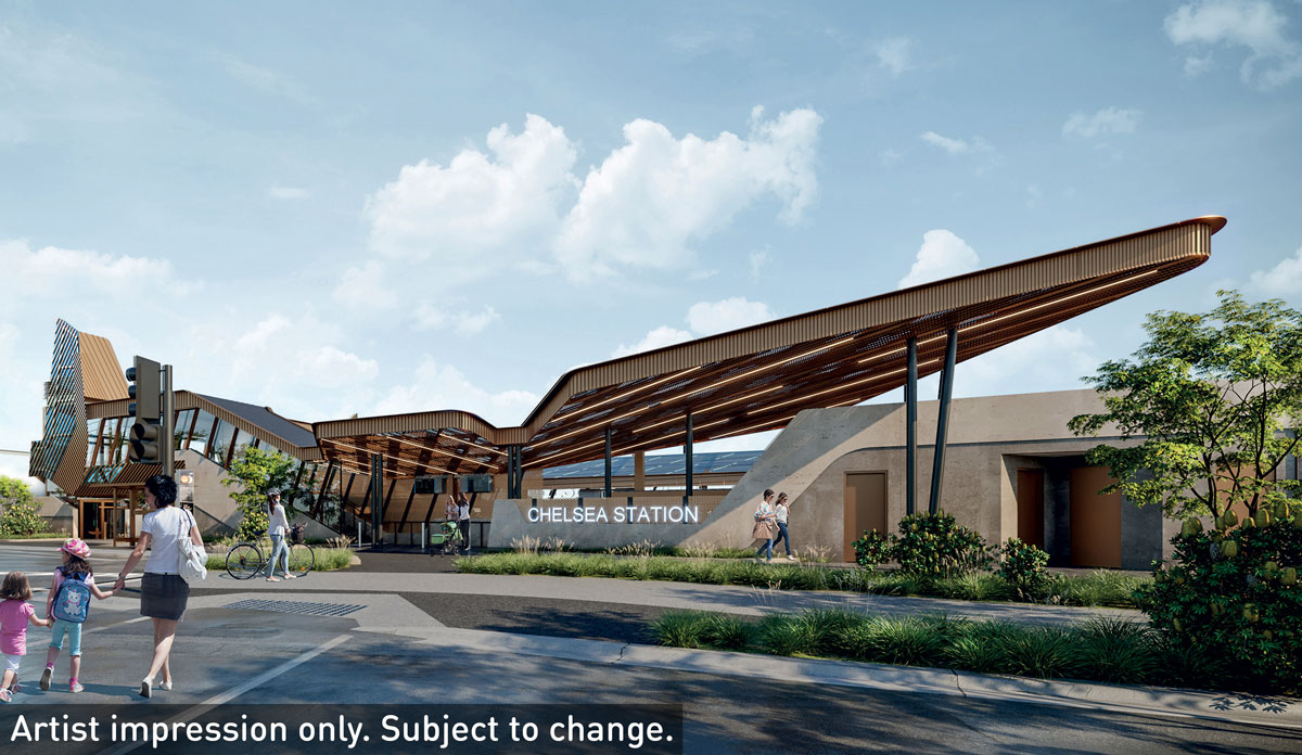 Artist impression of Chelsea Station at completion includes the new station building, pedestrians and a cyclist using the new path connection to the station and a signalised pedestrian crossing. The station has glass panelling and a rust/sand colour on the roof.