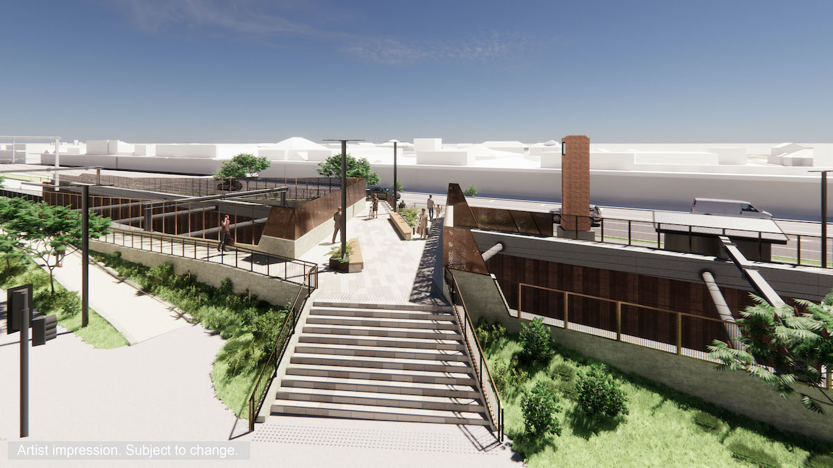 A wider view of the pedestrian bridge includes stairs and ramps for access, landscaping at the base of the bridge and rust coloured screening.