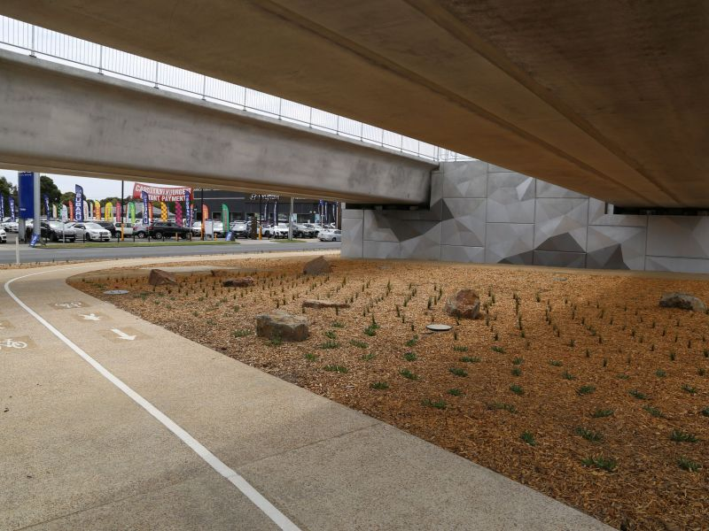 Shared use path and landscaping under the rail bridge