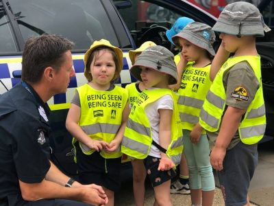 Police officer talking with children