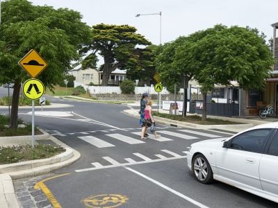 Slowing vehicle traffic in high pedestrian and cyclist areas such as a zebra crossing in a shopping strip