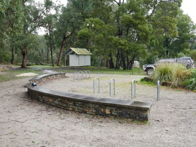 Forrest MTB Trailhead with toilets and bike parking and stone seating area on right of frame