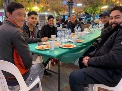 The committee enjoys some food at a community event