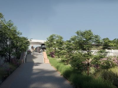 Entrance to the new station via Bedford Avenue includes a short staircase with landscaping along the pathway.