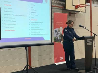 Police officer presenting to a community meeting